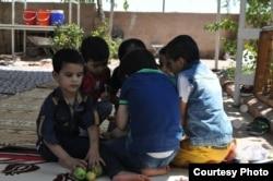 Children eat fruit at the Selam Orphanage. (M. Qarra)