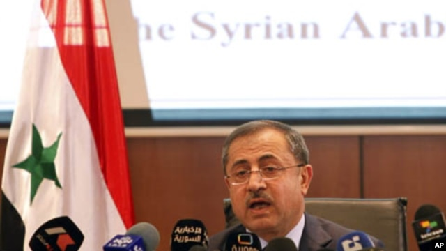 Syria's Interior Minister Mohammed al-Shaar announces the results of the referendum on a new constitution in Damascus, February 27, 2012.