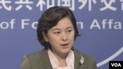 FILE - Foreign ministry spokeswoman Hua, Oct. 2013.