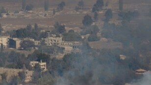 FILE - Smoke and fire rise in the Quneitra province as Syrian rebels clash with President Assad's forces, as seen from the Israeli controlled-Golan Heights, Aug. 27, 2014.