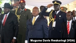 A government minister said on Sunday, Aug. 16, 2015, that President Salva Kiir (left) was convinced by regional leaders, and especially Ugandan President Yoweri Museveni (C.), to attend peace talks in Addis Ababa. The warring sides have until Monday to sign a peace deal.