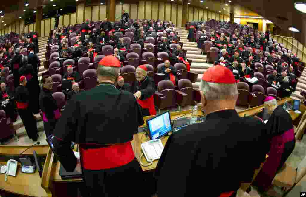 In this photo provided by the Vatican newspaper L'Osservatore Romano, cardinals attend a meeting at the Vatican. Cardinals from around the world have gathered for their first round of meetings before the conclave to elect the next pope.