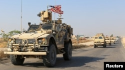 A convoy of U.S. vehicles is seen after withdrawing from northern Syria, on the outskirts of Dohuk, Iraq, October 21, 2019.