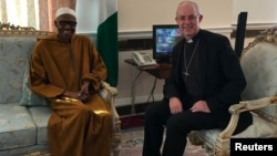 The Archbishop of Canterbury, Justin Welby, sits with Nigeria's President Muhammadu Buhari in Abuja House, London, March 9, 2017.