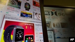 "An e-commerce website with a vendor selling the ""Apple Smart Watch Bluetooth Bracelet"" starting from 288 yuan (US$45) is displayed on a computer screen in Beijing, China, March 12, 2015."