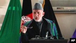 کرزي په ایران کې د ترکمنستان له جمهور رییس سره وکتل