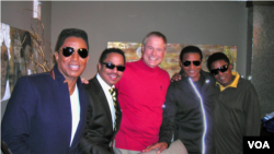 The Jacksons meet up with Border Crossings host Larry London for an interview on his VOA radio program.