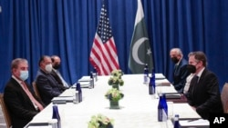 U.S. Secretary of State Antony Blinken, right, meets with Pakistani Foreign Minister Shah Mahmood Qureshi on the sidelines of the 76th U.N. General Assembly in New York City, Sept. 23, 2021.