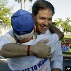Republican U.S.Senate candidate Marco Rubio greets a supporter at an early voting location in Miami, 20 Oct 2010