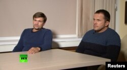 FILE - A still image taken from video footage and released by Russia's RT international news channel Sept. 13, 2018, shows two Russian men identified as Ruslan Boshirov (L) and Alexander Petrov during an interview at an unnamed location.