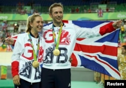 Gold medalist Jason Kenny of Britain poses with his girfriend, women's omnium gold medalist Laura Trott of Britain, at the Olympic Games in Rio de Janeiro, Brazil, Aug. 16, 2016.