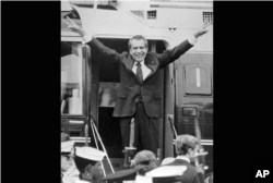 President Richard Nixon says goodbye to members of his staff outside the White House