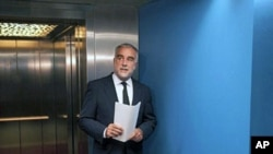 International Criminal Court (ICC) chief prosecutor Luis Moreno-Ocampo arrives to explain during a news conference at The Hague on May 16, 2011 his request for arrest warrants for Libyan leader Moamer Kadhafi, his son Saif al-Islam and the head of the mil
