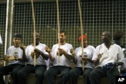 Pausa num treino de Capoeira Angola