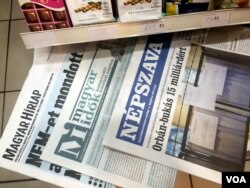 "Newspaper headlines in Budapest declare the referendum against EU-mandated refugee quotas a failure due to low turnout, saying ""The Country Said No"" and ""The Referendum Failed,"" despite government declarations of an overwhelming victory, Oct. 3 2016. (VOA"