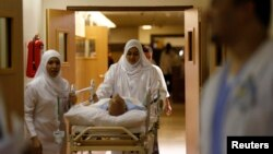 Nurses wheel a patient in the emergency department at Al-Noor Specialist Hospital in Mecca, Saudi Arabia, Sept. 30, 2014.