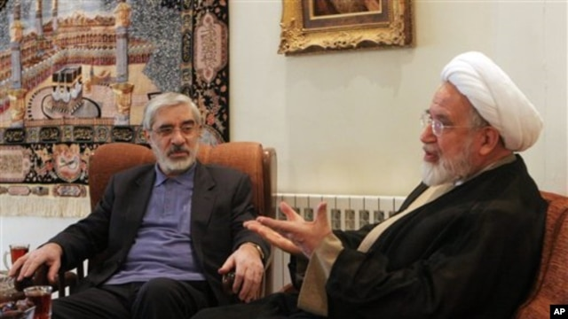 In this Saturday, Oct. 10, 2009 photo,  leaders of Iranian opposition, Mahdi Karroubi, right, and Mir Hossein Mousavi talk in Tehran, Iran