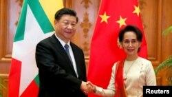 中国国家主席习近平和缅甸国务资政昂山素季1月18日举行会晤。
