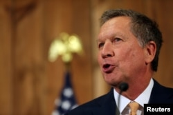 FILE - Ohio Governor John Kasich backs 'arming Ukrainians who want to fight for freedom.'