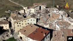 FILE - An aerial view of Castelluccio di Norcia the day after a strong earthquake hit central Italy, Oct. 31, 2016.