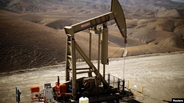 FILE - A pumpjack brings oil to the surface in the Monterey Shale, California, April 2013.