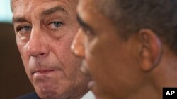 House Speaker John Boehner of Ohio listens as President Barack Obama speaks to media, Sept. 3, 2013.