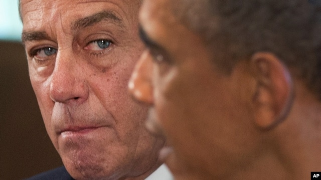 FILE - House Speaker John Boehner (L) and President Barack Obama