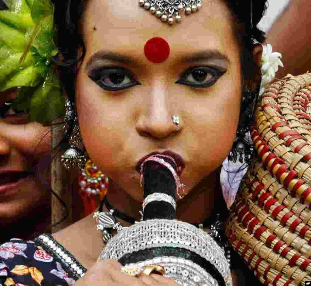 A girl dressed as a snake charmer participates in New Year celebrations in Dhaka, Bangladesh, April 13, 2012. (AP)