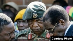 President Roberty Mugabe consulting some members of the Joint Operations Command in Harare