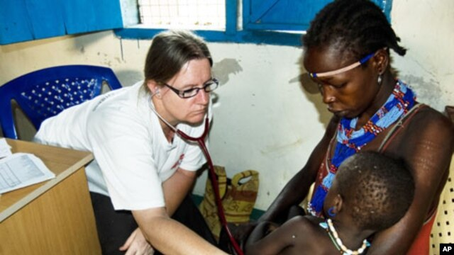 An MSF doctor examines a baby in Pibor town in South Sudan's Jonglei state in this 2012 file photo.