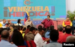 "Venezuela's President Nicolas Maduro, 2nd right, speaks during a meeting with members of the Constituent Assembly in Caracas, Venezuela, Aug. 2, 2017. The text in the back reads, ""Heroic Venezuela."""
