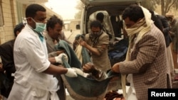 People carry the body of a man killed in an air strike on a market place in Yemen's northwestern province of Saada March 27, 2015. Warplanes targeted Houthi forces controlling Yemen's capital and their northern heartland on Friday, the second day of a Sau