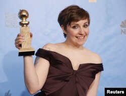 "FILE - ""Girls"" creator and actress Lena Dunham poses with the award ""Girls"" won for Best Televison Series, Comedy or Musical at the 70th annual Golden Globe Awards in Beverly Hills, California, Jan. 13, 2013."