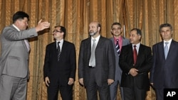 Mikhail Margelov, the Kremlin's Mideast envoy, left, welcomes a Syrian opposition delegation led by Washington-based rights activist Radwan Ziadeh, second from left, 28 June 2011.