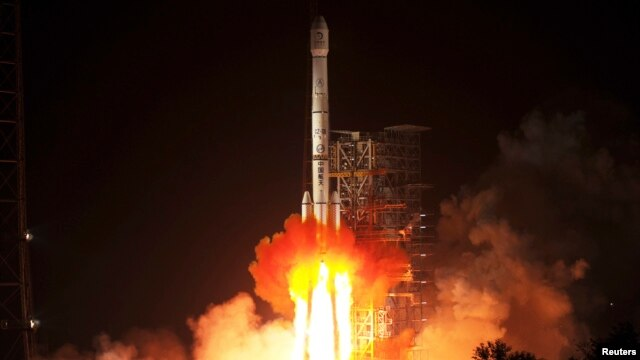The Long March-3B rocket carrying the Chang'e-3 lunar probe blasts off from the launch pad at Xichang Satellite Launch Center, Sichuan province, in the early morning hours, Dec. 2, 2013.