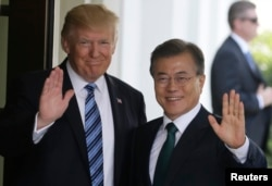 FILE - U.S. President Donald Trump, left, welcomes South Korean President Moon Jae-in at the White House in Washington, June 30, 2017.