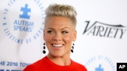 FILE - Pink arrives at Autism Speaks to LA Celebrity Chef Gala at Barker Hangar in Santa Monica, Calif.