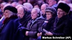 Holocaust survivors attend a ceremony at the Auschwitz-Birkenau Nazi death camp in Oswiecim, Poland, Monday, Jan. 27, 2020.