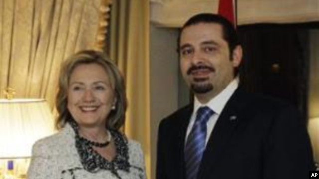 Lebanese Prime Minister Saad Hariri shakes hands with US Secretary of State Hillary Rodham Clinton in New York, 07 Jan 2011
