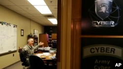 FILE - Col. Gregory Conti, military intelligence director of the Cyber Research Center at the United States Military Academy, sits in his office in West Point, New York, April 9, 2014.