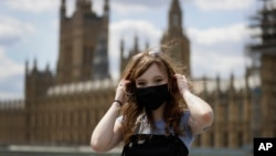 "Estelle Fitz poses for a photo as she stands on Westminster Bridge in London, Wednesday, July 22, 2020. She said, ""You should wear a mask for the safety of everyone,"" (AP Photo/Kirsty Wigglesworth)"