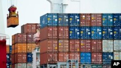 FILE - A container is loaded onto a cargo ship at the Tianjin port in China, Aug. 5, 2010. With the apparent death of the Trans-Pacific Partnership, China sees a chance at forming its own Pacific free trade area.