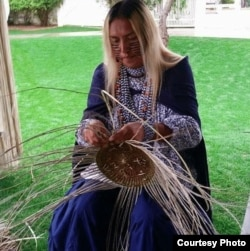 """Shown is Timothy """"Twix"""" Ward, San Carlos Apache two spirit, who specializes in the traditional craft of basket weaving. Courtesy: powwows.com"""