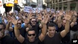 Demonstrators protest in Madrid, Spain, July 16, 2012