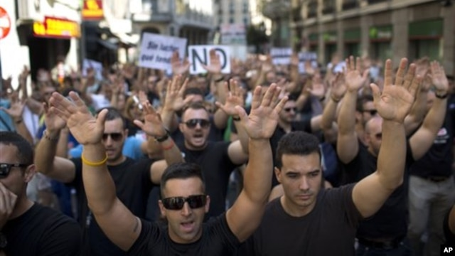 Demonstrators protest in Madrid, Spain, July 16, 2012