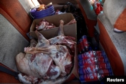 Sheep meat and cooking gas are seen in the back of a van. Mongolian customs officers are also taking more time to screen cargoes after their Chinese counterparts complained that raw meat and even guns had been secreted in coal heading to China, Davaasuren said.