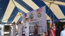 Commodore Ramon Joseph Mercado, Philippines exercises commander, Rear Admiral Jaime Bernardino, Philippine Fleet Commander and Rear Admiral Stuart Munsch, U.S. Commander of Submarine Group 7 stand to attention during opening rites of the joint naval exerc
