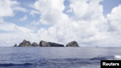 A group of disputed islands known as Senkaku in Japan and Diaoyu in China is seen from the city government of Tokyo's survey vessel in the East China Sea, September 2, 2012