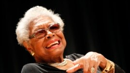 Maya Angelou answers questions at her portrait unveiling at the Smithsonian's National Portrait Gallery in Washington, April 5, 2014.