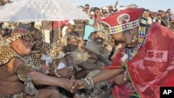 South African President Jacob Zuma marries his fiancee Bongi Ngema (R) at a traditional ceremony at his home in Nkandla, KwaZulu Natal province, April 20, 2012.